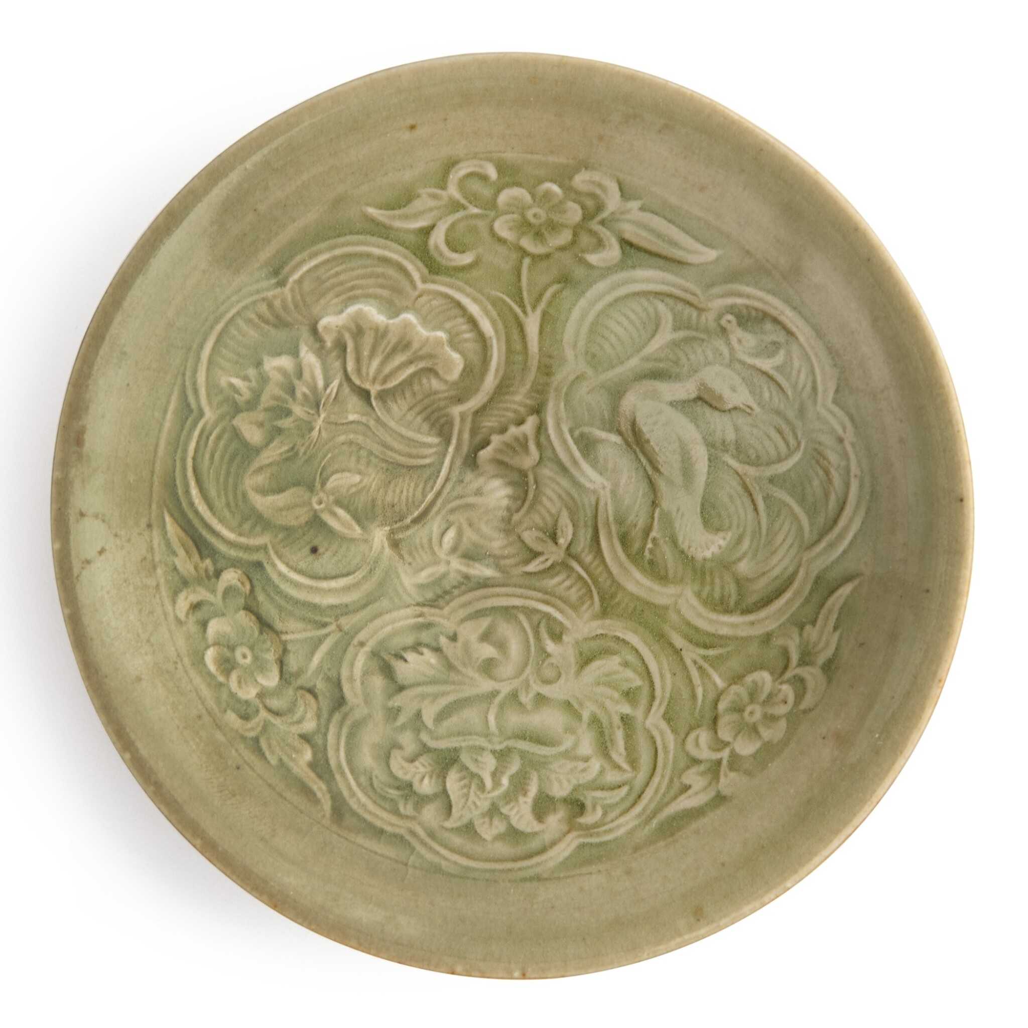View full screen - View 1 of Lot 110. A rare small molded 'Yaozhou' celadon-glazed bowl, Northern Song / Jin dynasty | 北宋 / 金 耀州窰青釉印花鴛鴦花卉紋小笠式盌.