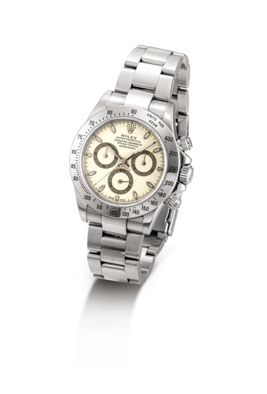 """View 2. Thumbnail of Lot 2019. ROLEX   COSMOGRAPH DAYTONA, REFERENCE 116520, A STAINLESS STEEL CHRONOGRAPH WRISTWATCH WITH CREAM DIAL AND BRACELET, CIRCA 2000    勞力士   """"Cosmograph Daytona 型號116520  精鋼計時鏈帶腕錶,備杏色錶盤,錶殼編號K735916,約2000年製""""."""