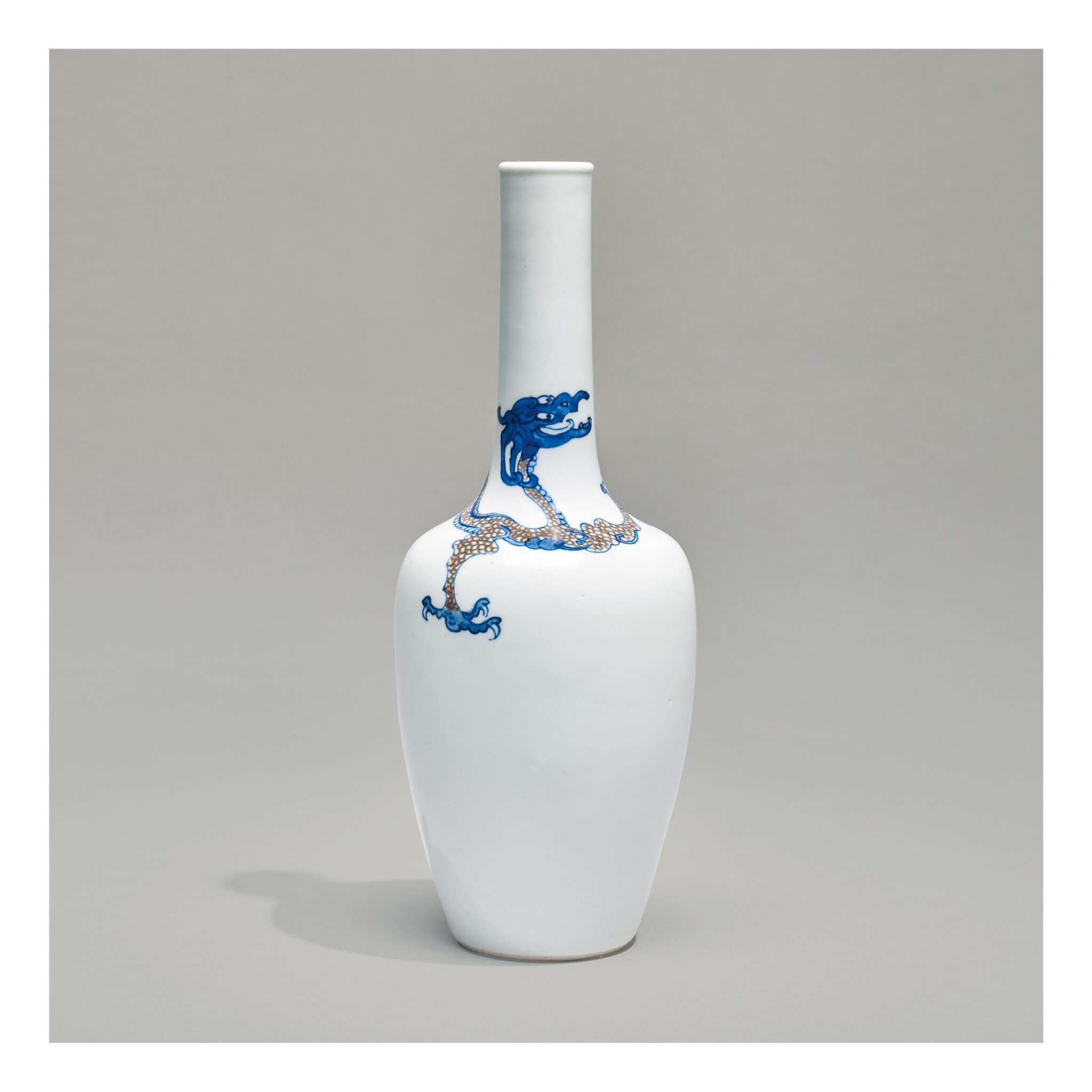 View full screen - View 1 of Lot 109. A RARE UNDERGLAZE-BLUE AND COPPER-RED 'DRAGON' BOTTLE VASE,  KANGXI MARK AND PERIOD.