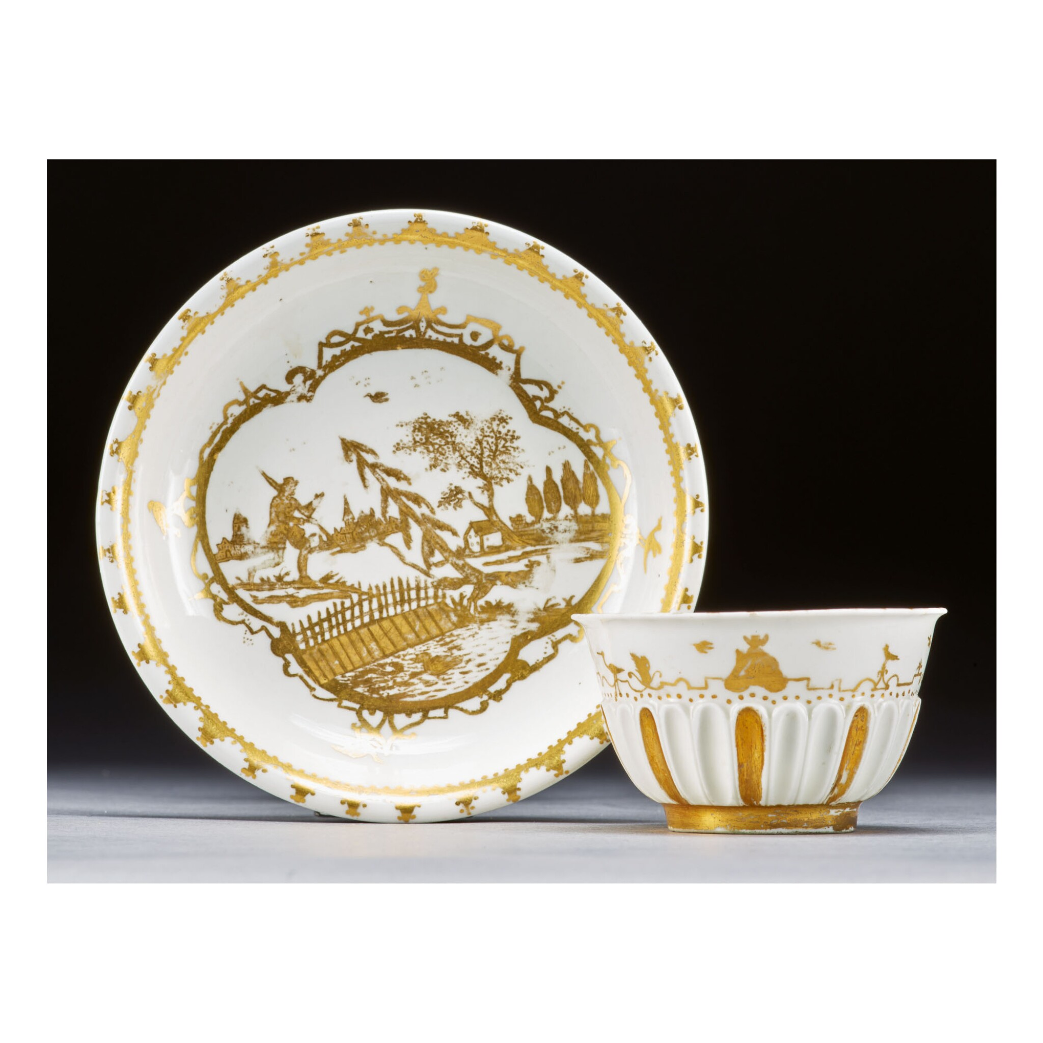 A MEISSEN HAUSMALER FLUTED TEABOWL AND SAUCER THE PORCELAIN CIRCA 1715-20, THE DECORATION CIRCA 1730