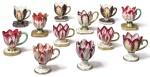 A GROUP OF TWELVE ENGLISH PORCELAIN TULIP ICE-CUPS, CIRCA 1820-30