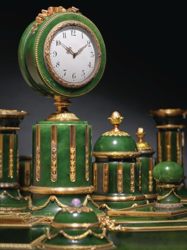 View 1. Thumbnail of Lot 34. A Highly Important Fabergé Varicolored Gold-Mounted Nephrite Desk Set, Workmaster Henrik Wigström, St Petersburg, 1903-1912.