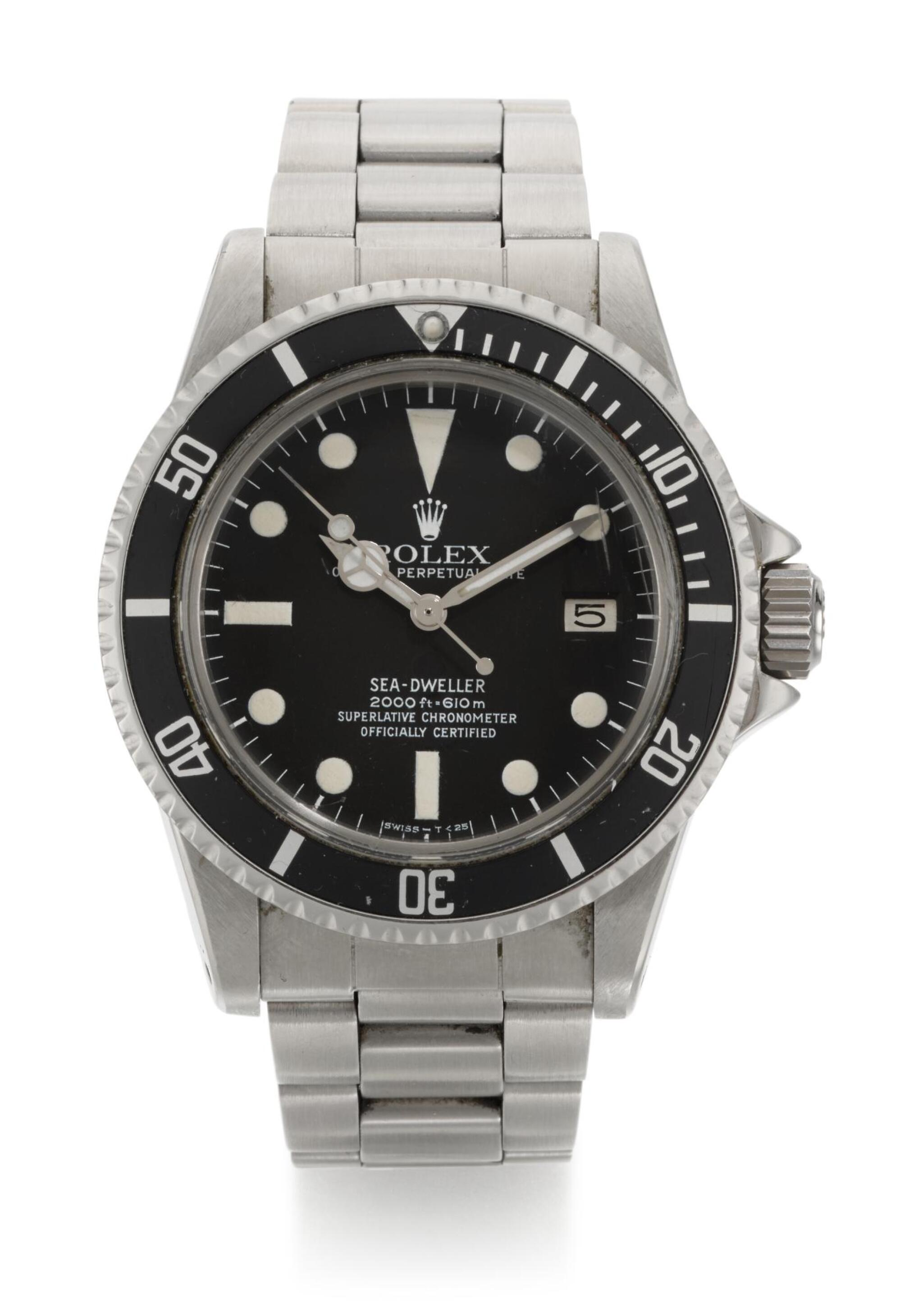 View full screen - View 1 of Lot 6. ROLEX    SEA-DWELLER GREAT WHITE, REFERENCE 1665, STAINLESS STEEL WRISTWATCH WITH HELIUM ESCAPE VALVE DATE AND BRACELET, CIRCA 1978.