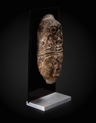View 3. Thumbnail of Lot 23. An important fragmentary relief head of an attendant Sui dynasty-Tang dynasty, ca. 7th century   隋至唐 約七世紀 石浮雕神首殘件.