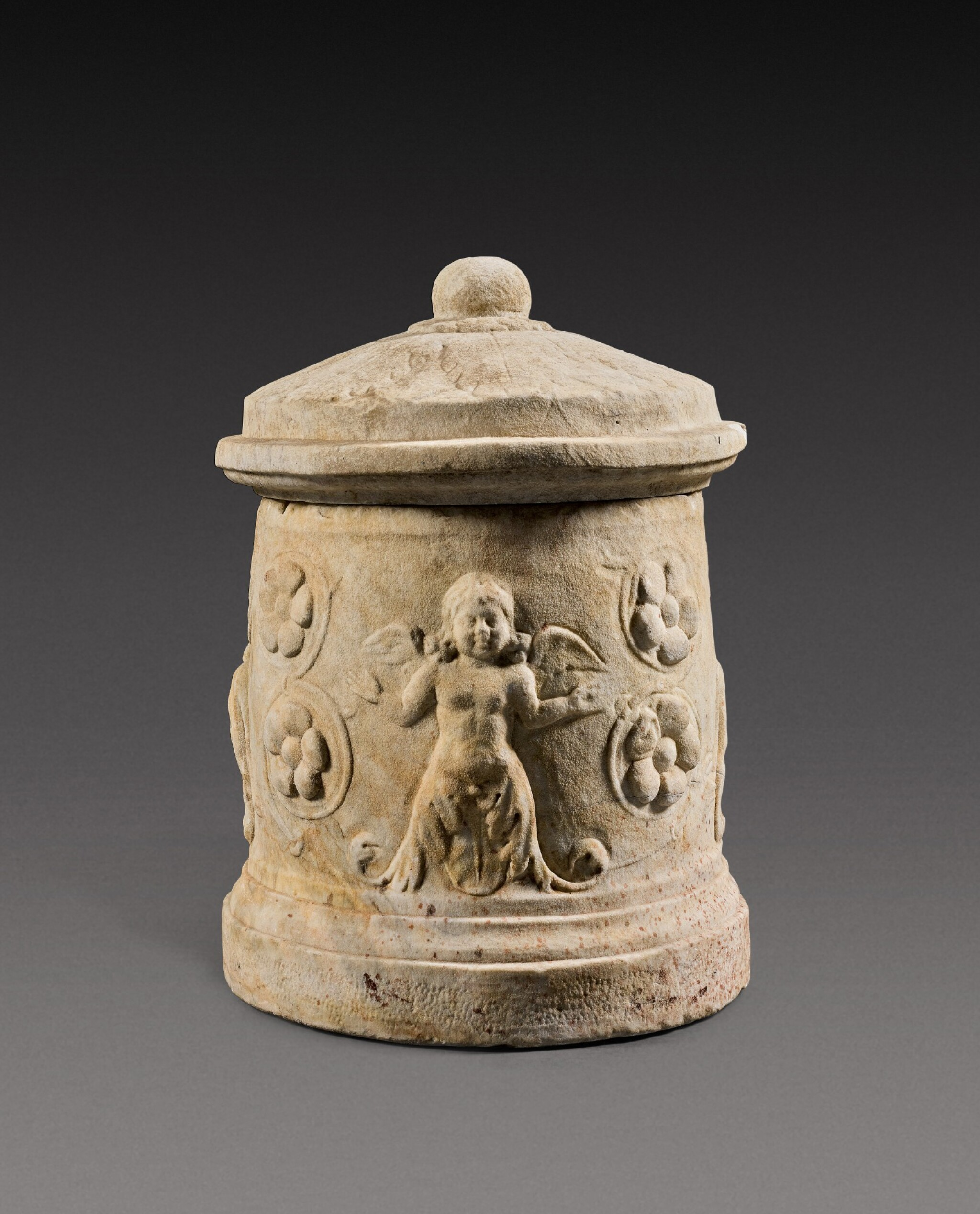 View full screen - View 1 of Lot 73. A Roman Marble Cinerary Urn and Lid, circa 1st Century A.D..