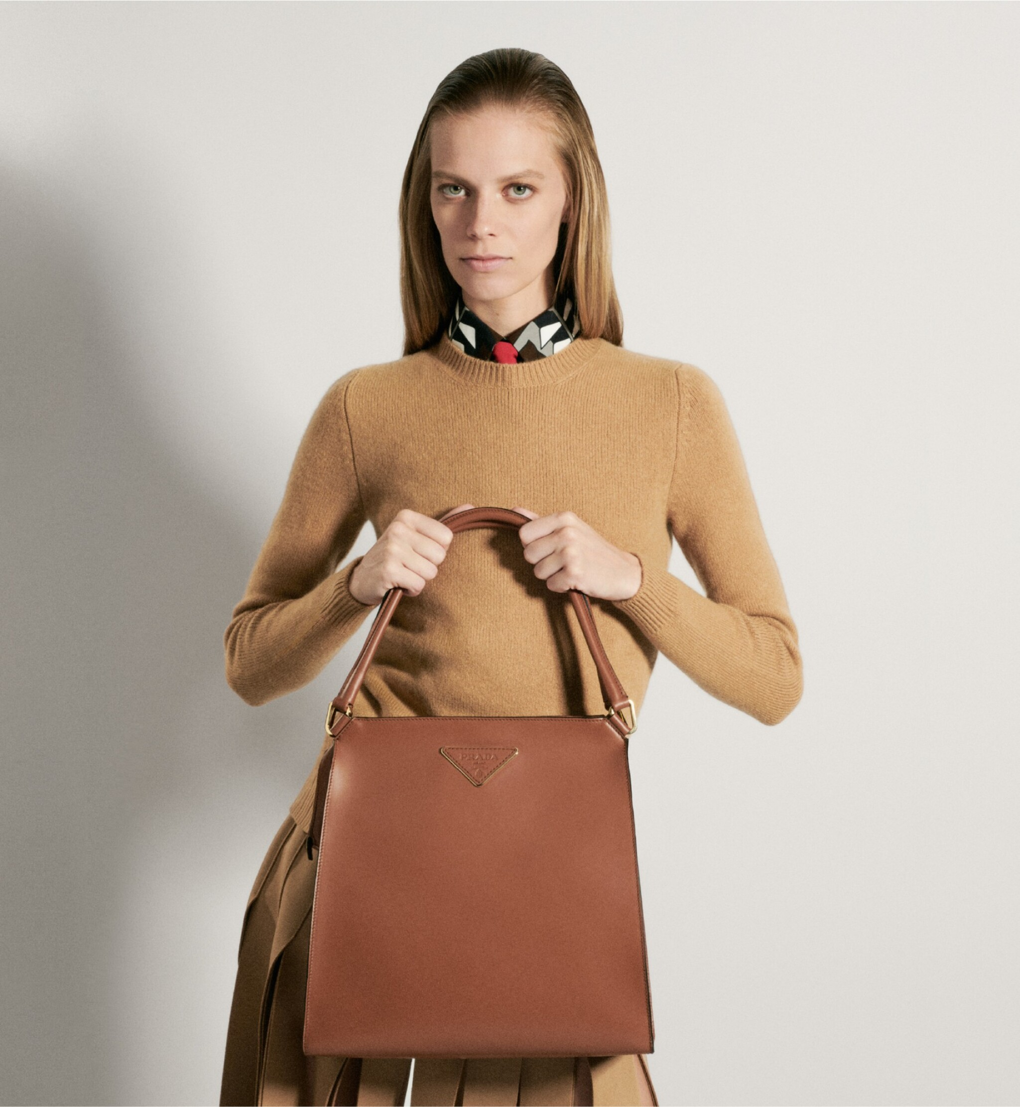 View full screen - View 1 of Lot 27. PRADA | LOUISE LEATHER TOTE, WORN BY LEXI BOLING.