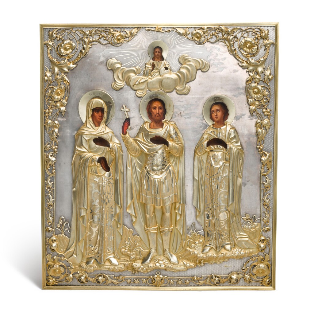A PARCEL-GILT ICON OF THE MARTYR SAINT ANDREW STRATELATES, SAINT ANNE AND MARTYR SAINT LUBOV', DMITRIY ORLOV, MOSCOW, 1856