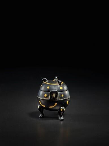 View 2. Thumbnail of Lot 123. A miniature archaistic parcel-gilt bronze tripod censer and cover, Song - Ming Dynasty   宋至明 銅局部鎏金袖珍仿古三足蓋爐.
