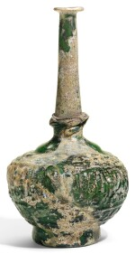 A LARGE MOULD-BLOWN GREEN GLASS SPRINKLER WITH CALLIGRAPHY, PERSIA, 12TH/13TH CENTURY