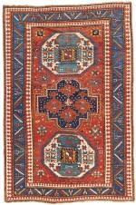 A KAZAK TRIPLE MEDALLION RUG, WEST CAUCASUS