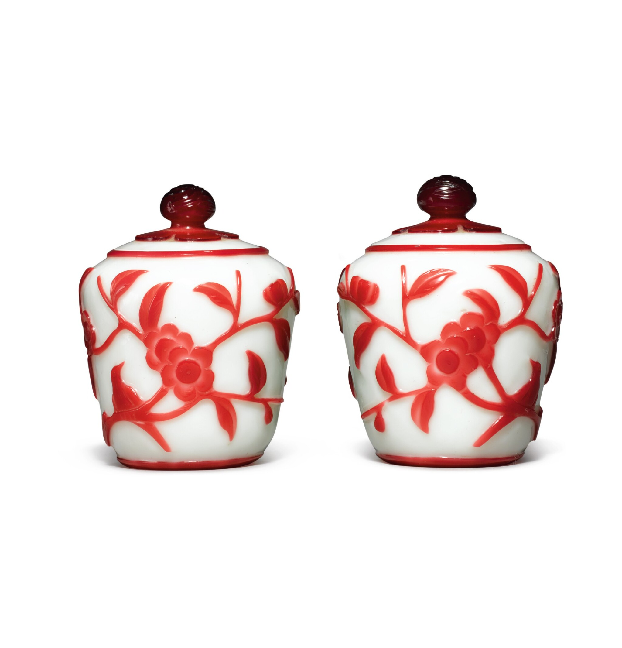 View full screen - View 1 of Lot 1023. A PAIR OF RED OVERLAY WHITE GLASS JARS AND COVERS,  QING DYNASTY.