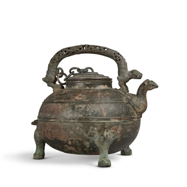 View 3. Thumbnail of Lot 15. An archaic bronze wine vessel and cover (He), Eastern Zhou dynasty, Warring States period   東周 戰國 青銅獸紋盉.