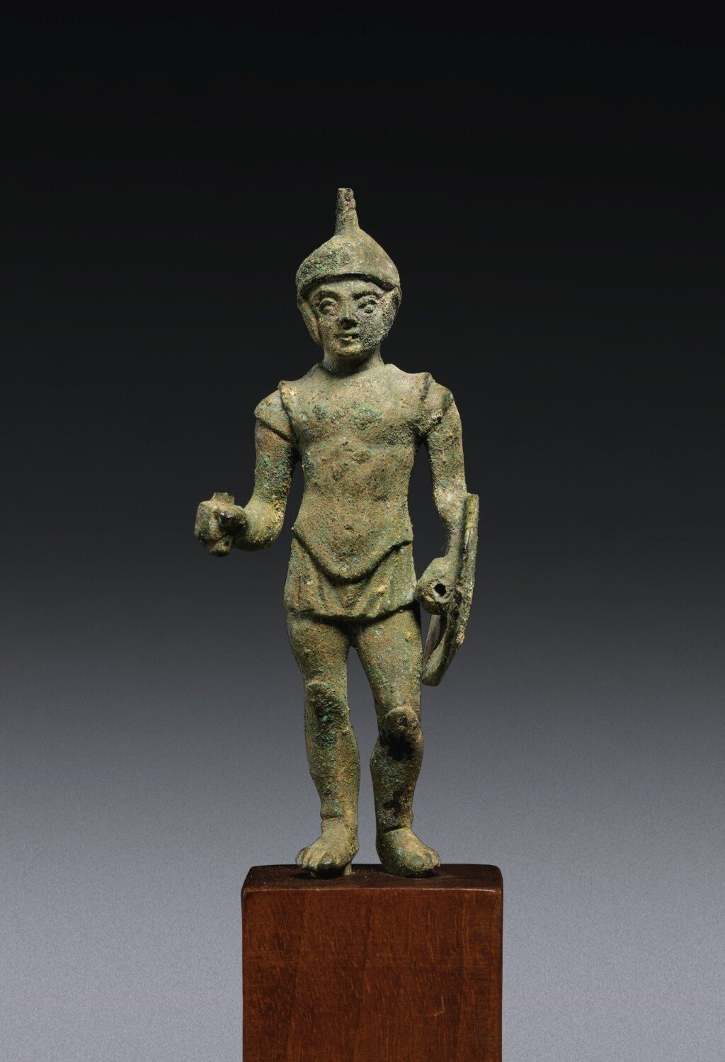 AN ITALIC BRONZE FIGURE OF A WARRIOR, CIRCA 3RD CENTURY B.C.