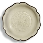 A carved 'Ding' 'dragon' dish, Northern Song dynasty   北宋 定窰白釉刻龍紋葵口盤
