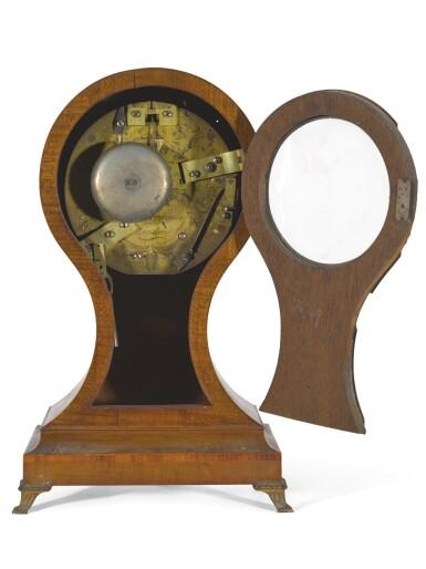 View 2. Thumbnail of Lot 37. A GEORGE III TULIPWOOD AND HAREWOOD BALLOON TABLE CLOCK, JOHN DWERRYHOUSE, LONDON, CIRCA 1790.