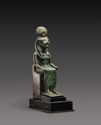 View 1. Thumbnail of Lot 38. An Egyptian Bronze Figure of a Lion-Headed Goddess, 26th Dynasty, 664-525 B.C..