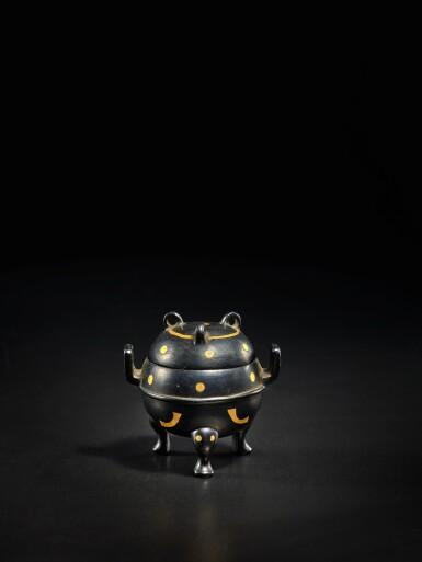 View 1. Thumbnail of Lot 123. A miniature archaistic parcel-gilt bronze tripod censer and cover, Song - Ming Dynasty   宋至明 銅局部鎏金袖珍仿古三足蓋爐.