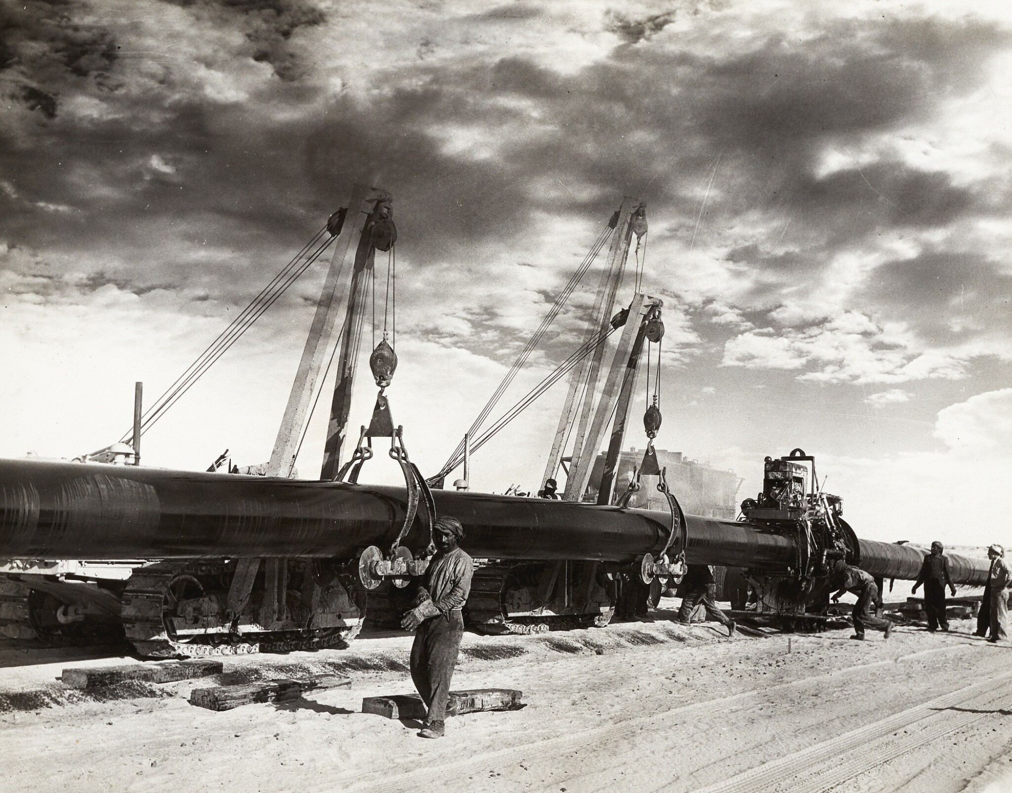 View full screen - View 1 of Lot 210. Saudi Arabia. Album of photographs of the construction of the Trans-Arabian Pipeline, 1950s.