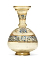 A HIGHLY IMPORTANT MAMLUK GILDED AND ENAMELLED GLASS FLASK, SYRIA, MID-13TH CENTURY