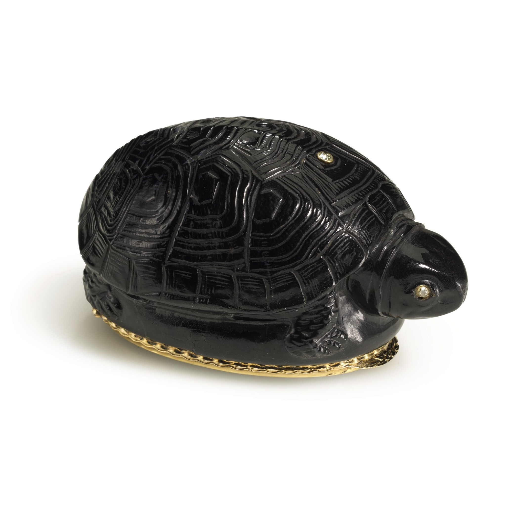 View full screen - View 1 of Lot 37. A gold-mounted black jasper snuff box in the shape of a turtle, probably German, 19th century.