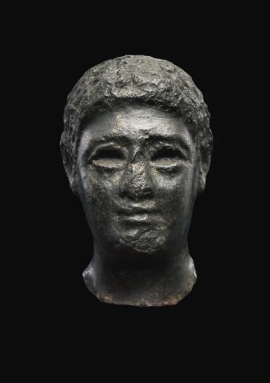 View 1. Thumbnail of Lot 55. AN EGYPTIAN BASALT HEAD OF A MAN, LATE PTOLEMAIC PERIOD, CIRCA 100-30 B.C..