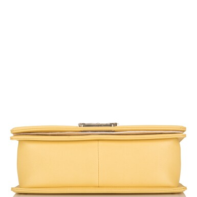 View 7. Thumbnail of Lot 98. CHANEL |  YELLOW CHEVRON OLD MEDIUM BOY BAG OF CAVIAR LEATHER WITH LIGHT GOLD TONE HARDWARE.