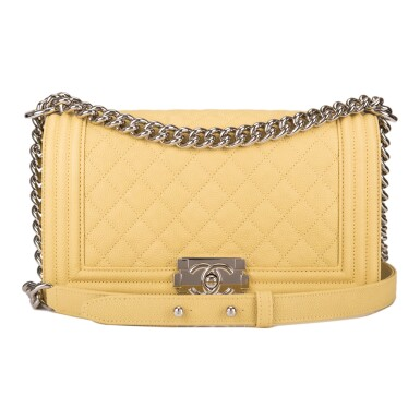 View 1. Thumbnail of Lot 84. Chanel Yellow Quilted Old Medium Boy Bag of Caviar Leather with Silver Hardware.