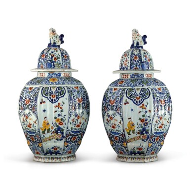 A PAIR OF DUTCH DELFT POLYCHROME OCTAGONAL VASES AND COVERS, 19TH CENTURY