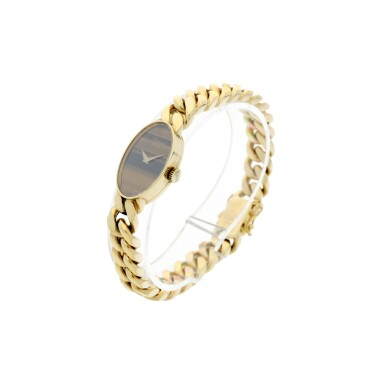 View 2. Thumbnail of Lot 221. REFERENCE 5026/1 A LADY'S YELLOW GOLD BRACELET WATCH WITH TIGER EYE DIAL, CIRCA 1990'S.