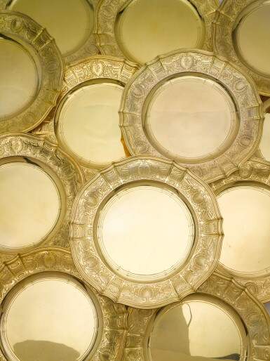 View 2. Thumbnail of Lot 82. A SET OF SIXTEEN AMERICAN SILVER-GILT PLACE PLATES, TIFFANY & CO., NEW YORK, CIRCA 1910.