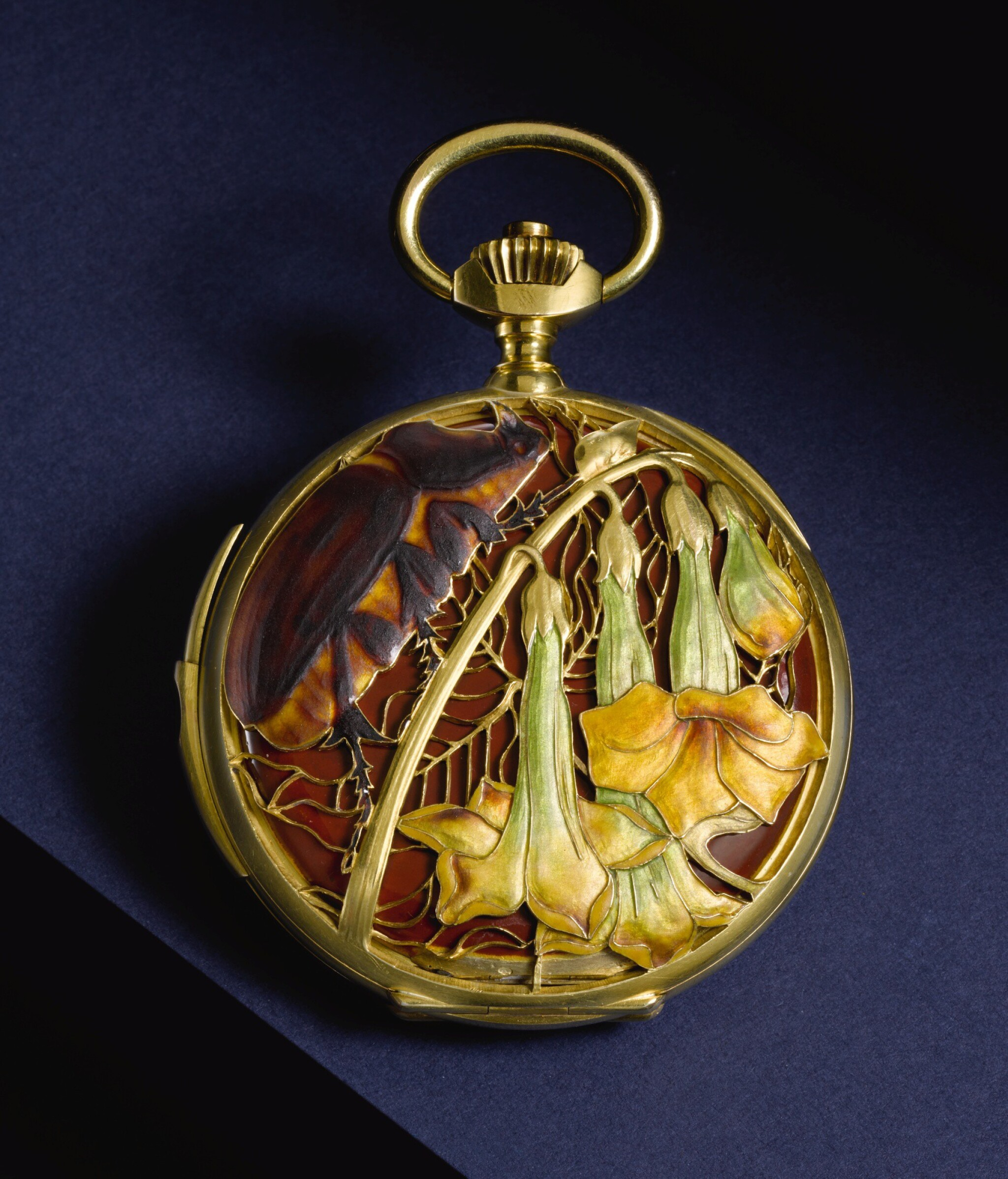 View full screen - View 1 of Lot 75. RENÉ LALIQUE | AN EXTREMELY RARE AND UNUSUAL ART NOUVEAU GOLD HUNTING CASED KEYLESS LEVER QUARTER REPEATING WATCH, THE PIERCED COVERS WITH PÂTE DE VERRE DECORATION   CIRCA 1900, NO. 17120 [極罕有新藝術風格黃金二問報時懷錶,穿孔錶蓋飾粉末鑄造玻璃,年份約1900,編號17120].
