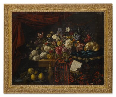 A still life of flowers set on a table with a carpet, a music book and a dog seated on a pillow