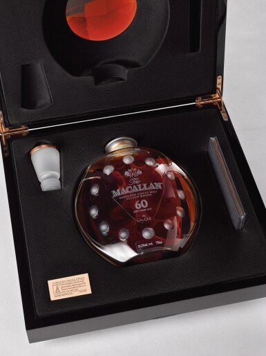 View 3. Thumbnail of Lot 2004. The Macallan In Lalique - Curiously Small Stills Decanter, 60 Years Old.