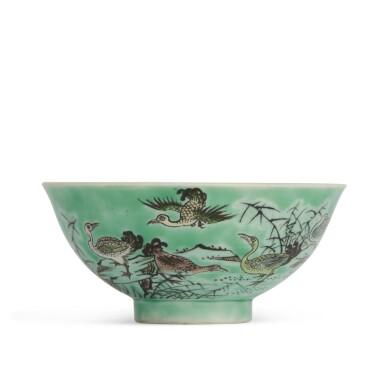 View 1. Thumbnail of Lot 202. A biscuit-glazed famille-verte 'ducks' bowl, 20th century | 二十世紀 素三彩鴛鴦蘆葦圖盌 《大清康熙年製》仿款.
