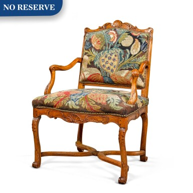 View 1. Thumbnail of Lot 52. A Régence provincial carved beechwood fauteuil, circa 1730.
