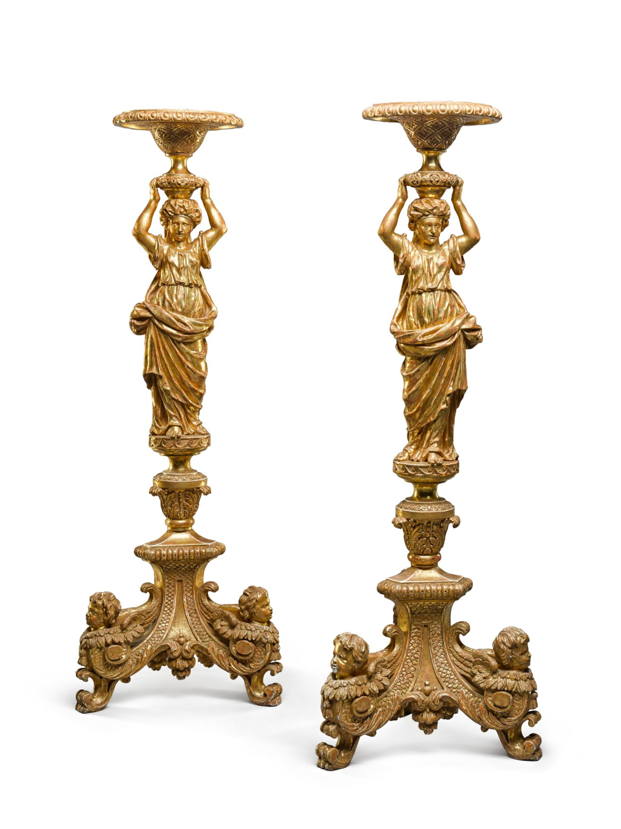 View full screen - View 1 of Lot 30. A pair of George II carved giltwood torchères, second quarter 18th century, after a design by Alexis Loir.