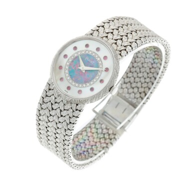 View 3. Thumbnail of Lot 109. Reference 9005 D 2 A white gold, mother-of-pearl, opal, diamond and ruby-set bracelet watch, Circa 1975.