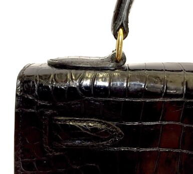 View 12. Thumbnail of Lot 743. HERMÈS | BLACK KELLY 28 IN SHINY CROCODILE WITH GOLD HARDWARE, 1962.