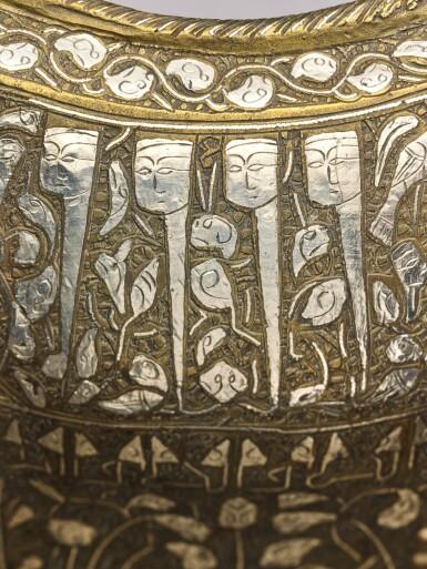 View 8. Thumbnail of Lot 74. A rare and important Khurasan silver-inlaid brass basin, probably Herat, circa 1200.