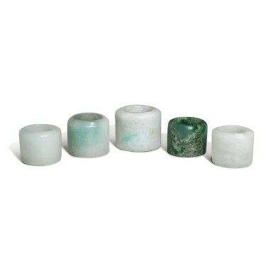 View 1. Thumbnail of Lot 163. Five jade and jadeite archer's rings, 19th / 20th century.