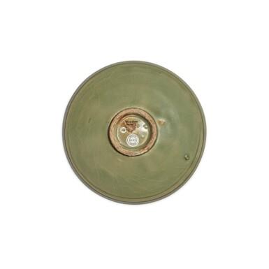 View 2. Thumbnail of Lot 95. A carved 'Yaozhou' celadon-glazed dish, Northern Song / Jin dynasty   北宋 / 金 耀州窰青釉刻蓮紋盤.