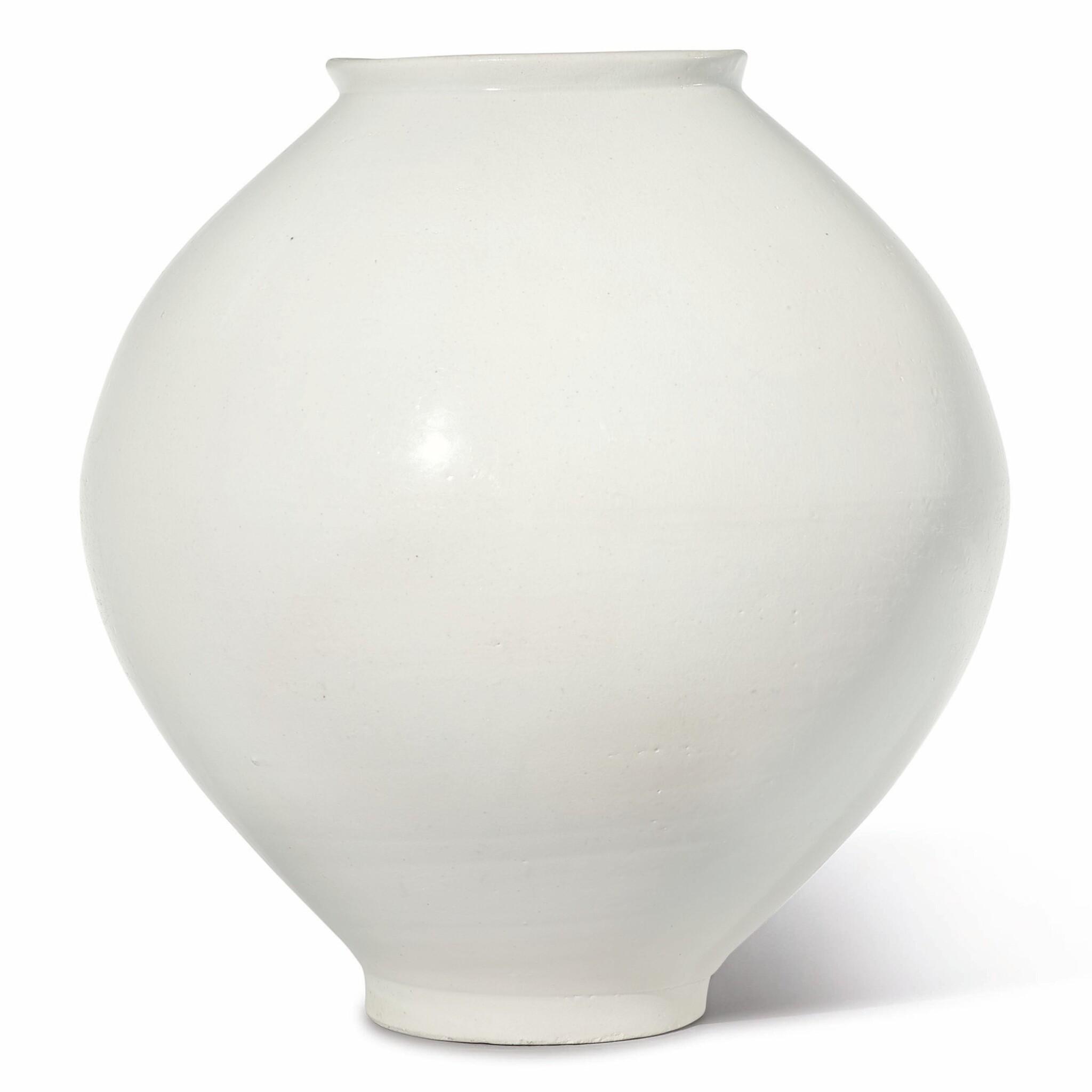View full screen - View 1 of Lot 129. A luminous white moon jar, Korea, Joseon dynasty, 18th century | 朝鮮王朝 十八世紀 白釉滿月花罐.