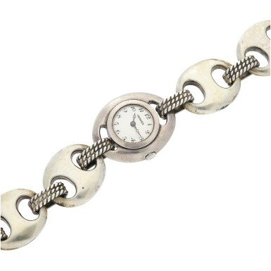 View 6. Thumbnail of Lot 238. RETAILED BY HERMES: A LADY'S STERLING SILVER BRACELET WATCH, CIRCA 1955.