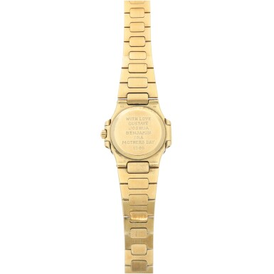 View 5. Thumbnail of Lot 34. REFERENCE 4700/1 NAUTILUS RETAILED BY TIFFANY & CO.: A LADY'S YELLOW GOLD BRACELET WATCH WITH DATE, CIRCA 1985.