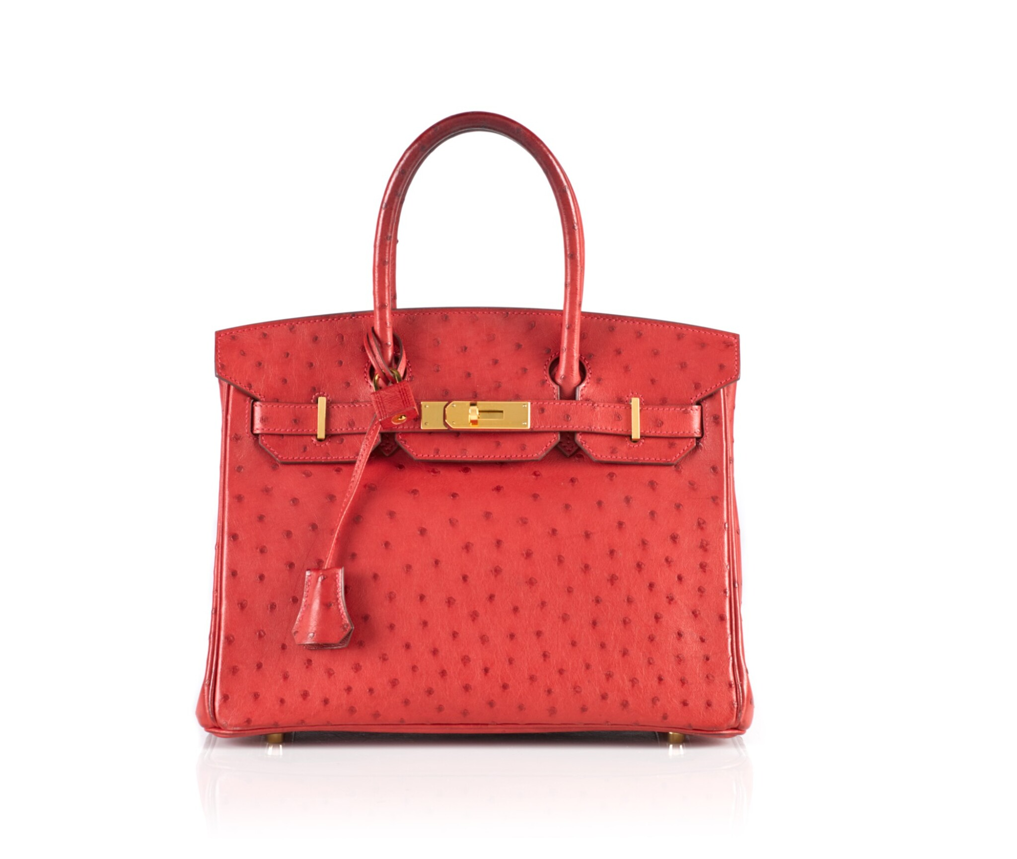View full screen - View 1 of Lot 1.  BIRKIN 30 OSTRICH LEATHER IN ROUGE VIF COLOUR WITH GOLD HARDWARE. HERMÈS, 2016.