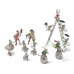 ANIMAL TRAINERS: A GROUP OF SILVER AND ENAMEL CIRCUS FIGURES, DESIGNED BY GENE MOORE FOR TIFFANY & CO., NEW YORK, CIRCA 1990
