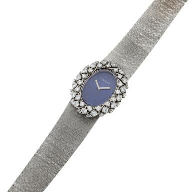 View 6. Thumbnail of Lot 158. A white gold and diamond-set bracelet watch with lapis lazuli dial, Circa 1980.