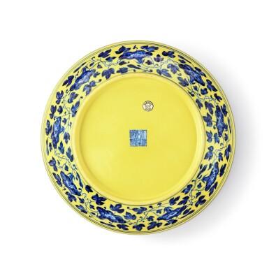 View 2. Thumbnail of Lot 72. A yellow-ground underglaze-blue 'nine peaches' dish, Seal mark and period of Qianlong   清乾隆 黃地青花九桃紋盤 《大清乾隆年製》款.