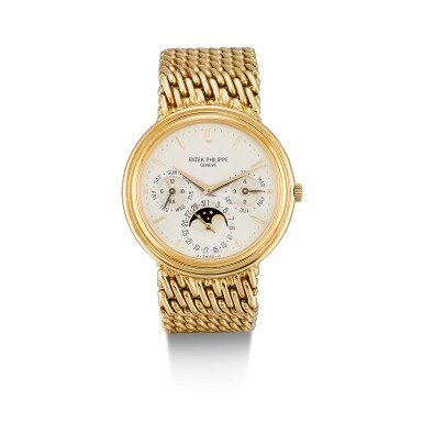 PATEK PHILIPPE     REFERENCE 3945,  A YELLOW GOLD PERPETUAL CALENDAR BRACELET WATCH WITH MOON PHASES, 24 HOURS AND LEAP YEAR INDICATION, CIRCA 1993
