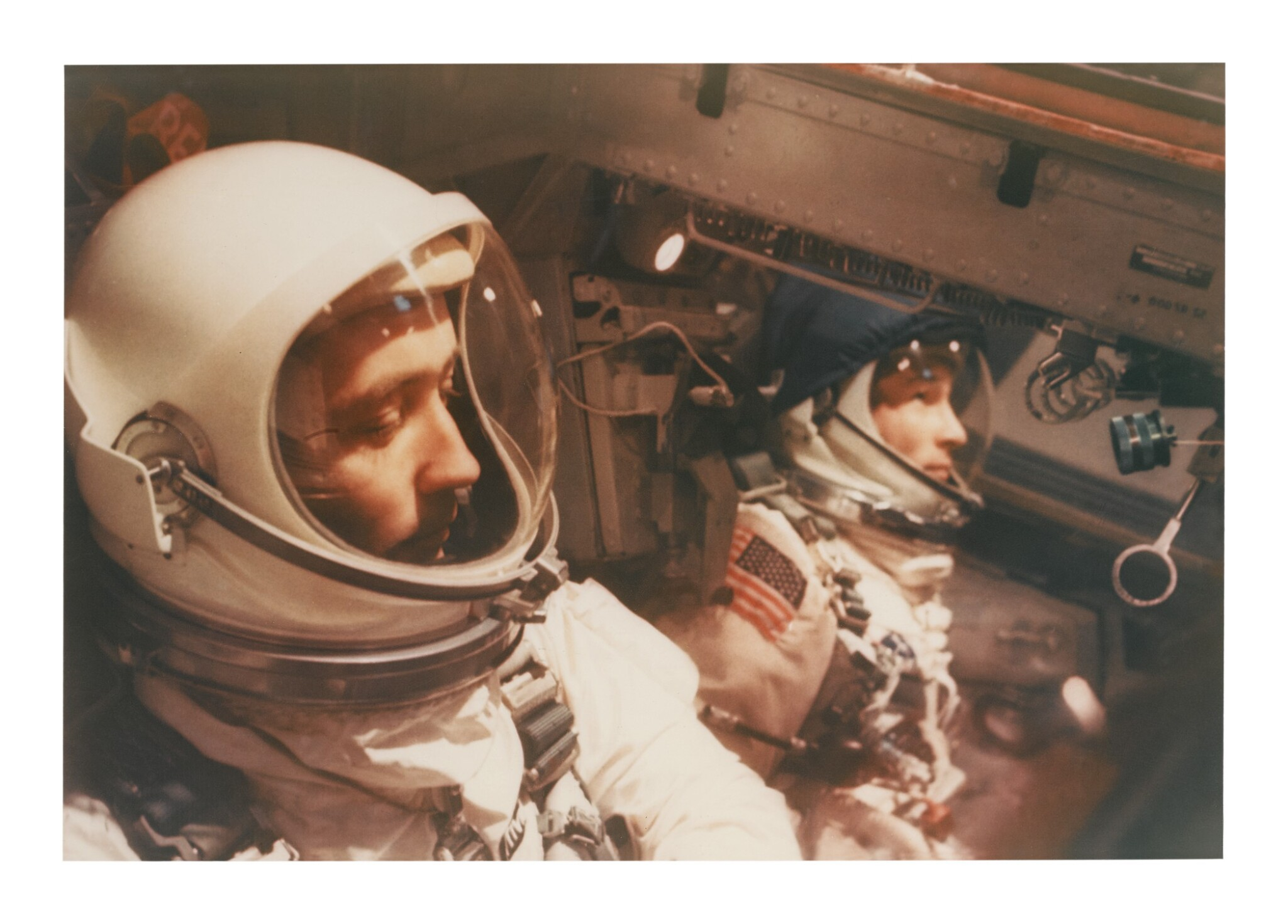 """[GEMINI 3] VINTAGE CHROMOGENIC PRINT OF VIRGIL """"GUS"""" GRISSOM AND JOHN YOUNG IN THE SPACE CAPSULE, CA MARCH 1965."""